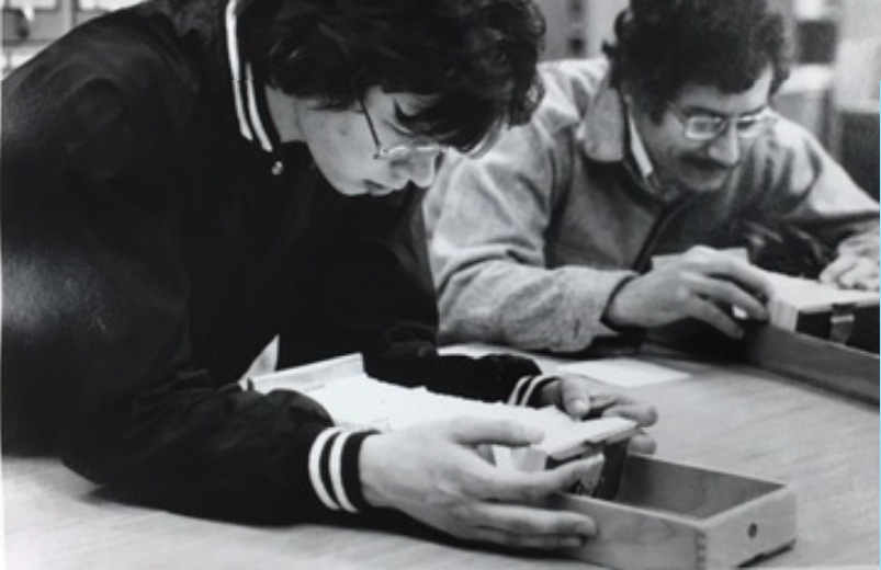 Students using the Engineering Library card catalog, 1977